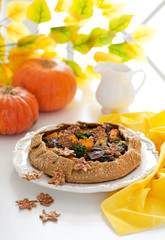 Galette with pumpkin, mushrooms and broccoli, selective focus