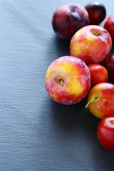 fresh plum on a dark background