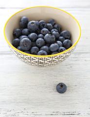 Fresh blueberries in  bowl on  white background