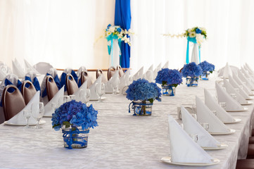 Hydrangea Flowers in Vases on Festive Table with Cutlery.