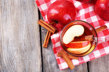 Apple cider with cinnamon sticks and fresh apples