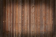 Wall of wooden boards with vignette. Can be used as background.