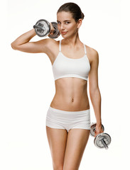 Young fit girl going in for sport with dumbbells