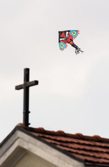 Devil dragon and holy cross