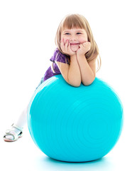 Positive little girl with the blue ball.