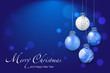 Shiny christmas balls on blue background - place for your text