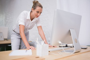Businesswoman using computer at office