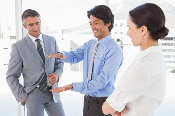 Happy employees having a discussion