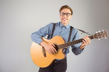 Geeky hipster playing the guitar