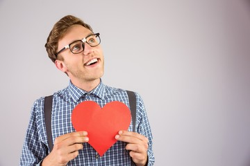 Geeky hipster holding a heart card