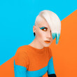 Fashion model with bright makeup and multi-coloured hair. Art ph