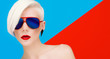 Fashion blond model with trendy haircut and sunglasses on bright