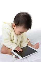 Asian baby touching  with tablet PC