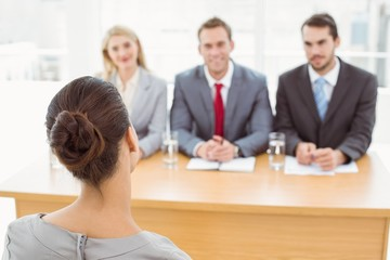 Business people interviewing woman