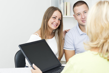 Young couple with financial advisor.
