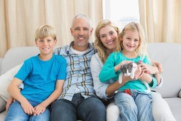 Happy family with their pet kitten