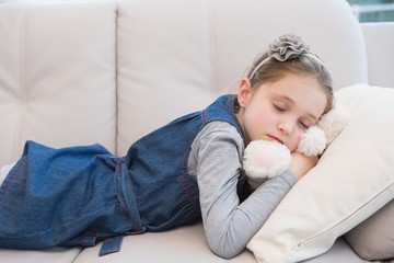 Little girl napping on the couch