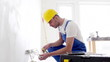 builder with tablet pc and equipment indoors