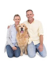 Portrait of smiling couple sitting together with their dog