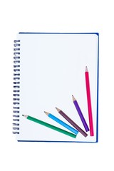 blank notebook with metal spiral and two crayons