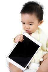 Asian baby play game with tablet PC