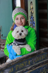 Winter vacation - portrait of lovely girl with dog