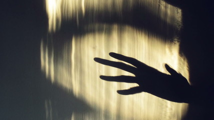Spooky hand shadow crawling on the wall. 1920x1080 full hd