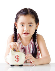 little girl saving money in a piggy bank,money saving concept.