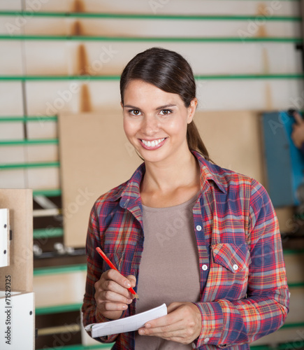 Leinwandbild Motiv Confident Carpenter Holding Pencil And Paper