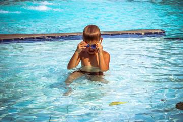 Little boy having fun in the swimming pool