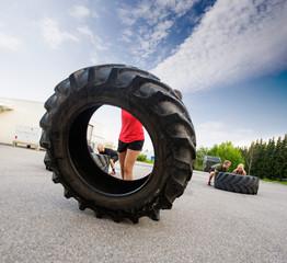 Athlete Flipping Large Tire
