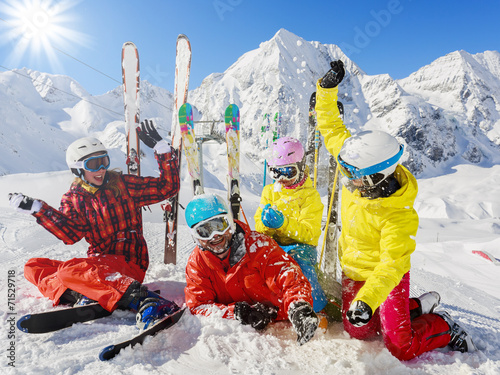 canvas print picture Skiing, winter, snow, skiers, sun and fun - family enjoying wint