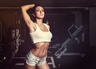 Young sexy woman after workout in gym