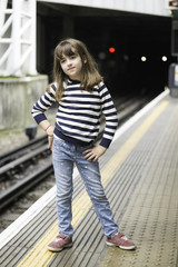 Little girl waiting the train