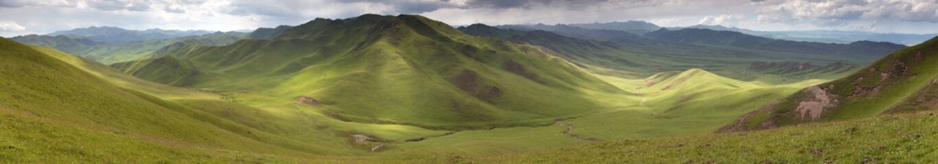 Panaramic view of green mountains - East Tibet