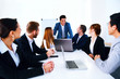 Businesspeople sitting at the table on a meeting