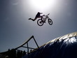 dirtbike bmx rider jumps against sun - 71531587