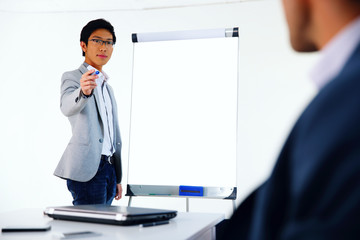 Portrait of a businessman presenting something on a meeting
