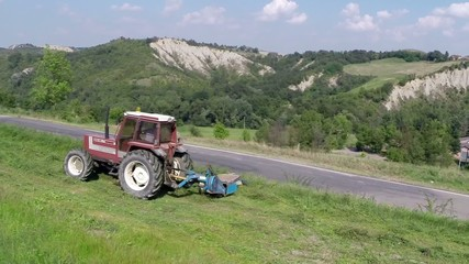 Tractor at work cutting the grass