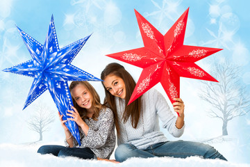 Cute girls holding paper stars.