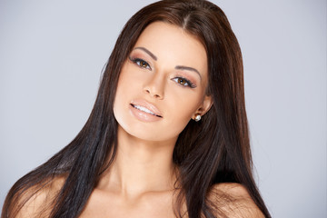 Brunette Woman with Long Hair and Bare Shoulders