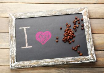 I love coffee written on chalkboard, close-up