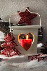Flash light and Christmas decoration on light background