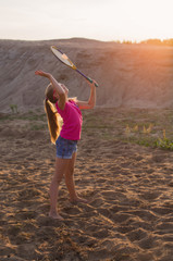 girl playing badminton outdoor