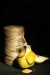 Ripe tasty pear on wooden table, on dark background