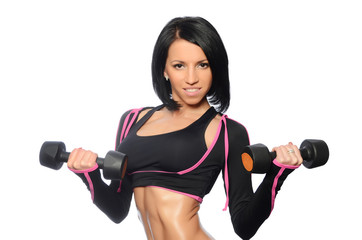 The woman with a beautiful body with dumbbells