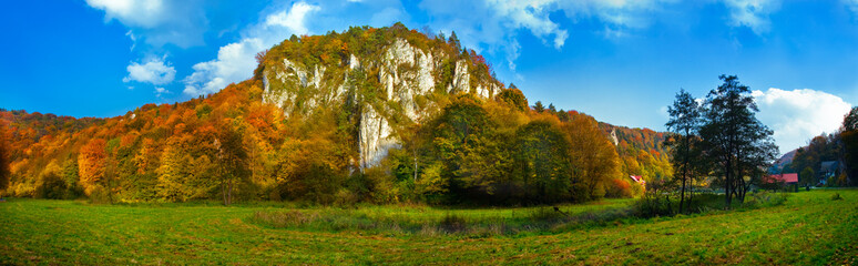 Autumn panoramic view of the limestone cliffs in the park