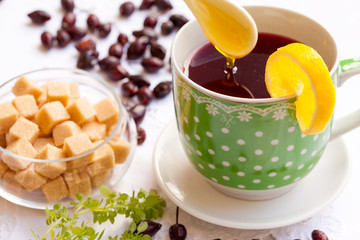 Cup of hip roses tea with lemon and honey