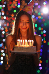 Young girl with cake in club