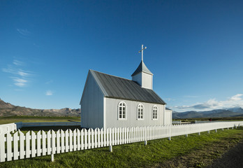 Typical Rural Icelandic Church under a blue summer sky.